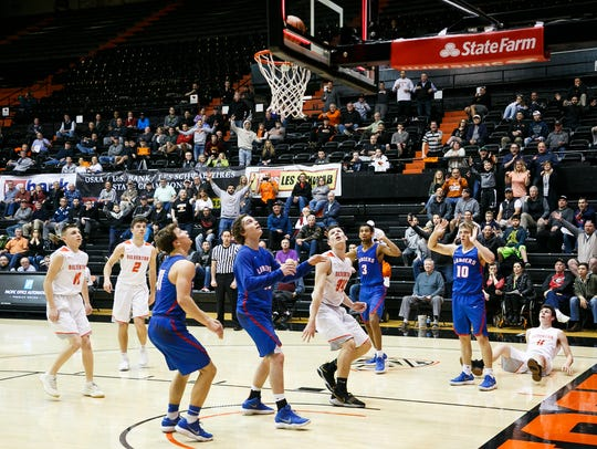Silverton's Levi Nielsen (34) and teammates watch as Nielsen's shot drops into the basket after the final buzzer in a 53-51 loss to Churchill on Wednesday, March 7, 2018, in the 5A state quarterfinals at Gill Coliseum in Corvallis.