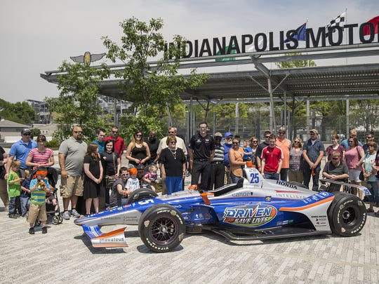 Hoosiers awaiting organ transplants and their families helped reveal the number 25 Driven2SaveLives Honda that Stefan Wilson will drive in the Indianapolis 500, at Indianapolis Motor Speedway, Monday, May 14, 2018. IndyCar driver Stefan Wilson, the Indiana Donor Network, Andretti Autosport and sponsor Intelisys led the unveiling.