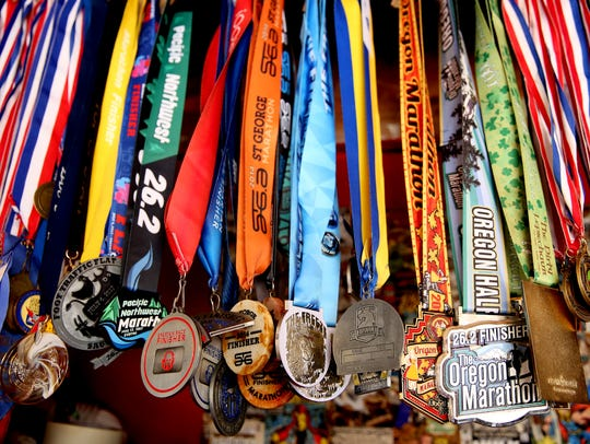 Race medals earned by Kacey McCallister, a double amputee,