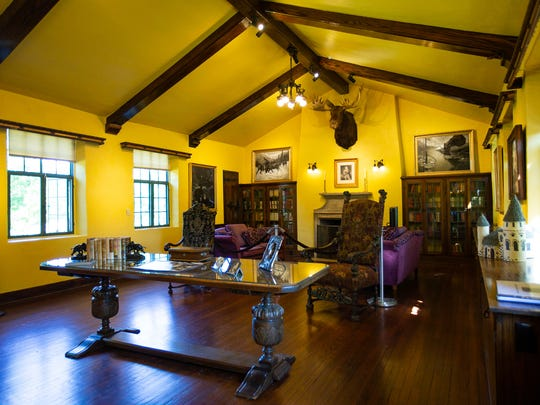 The large living area inside the Curwood Castle features ornate chairs, countless books and a collection of paintings.