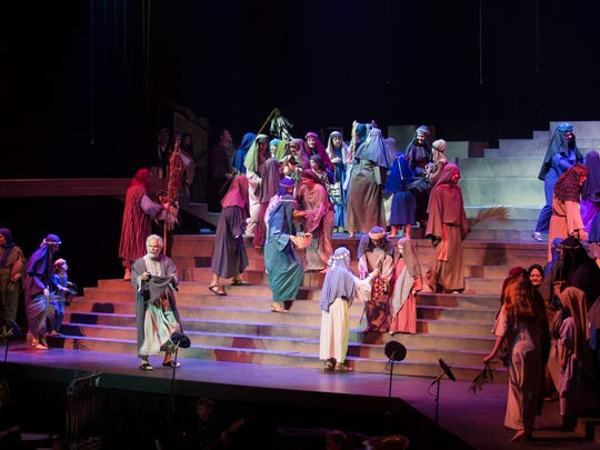 A crowd scene from the 2015 production of Pioneer Drive Baptist Church's Easter pageant. Mac McConnell, facing the audience, portrays Peter.