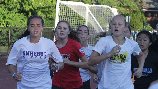 Bronxville's girls soccer team jogs around the track at Bronxville High School on Monday, August 22nd, during the first day of practices of the 2016 season.