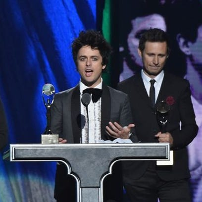 uctees Tre Cool, left, Billie Joe Armstrong and Mike