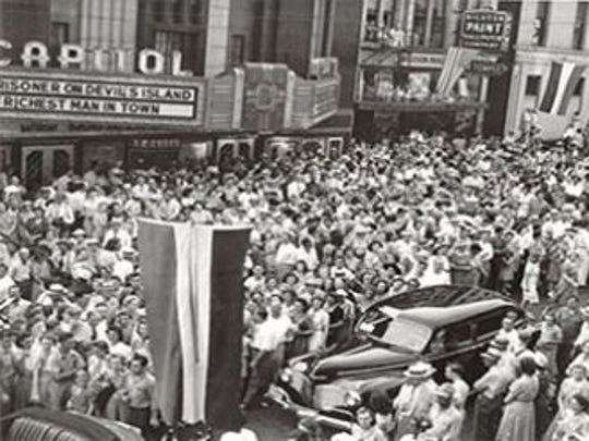 The Capitol Theater, shown during a 1941 parade, was