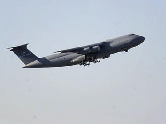 A plane leaves Dover Air Force Base.
