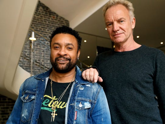 Shaggy (left) and Sting pose in Paris on March 26,