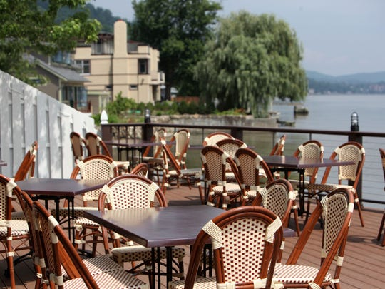 Outdoor dining with Hudson River views are seen at Pier 701 in Piermont.