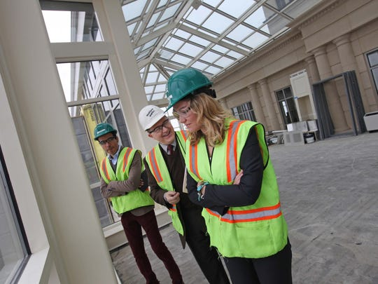 Left to right, Jesus Urdiales, a school leader for the Academia Antonia Alonso Charter School, Riccardo Stoeckicht, the building's director, and Sally Maldonado, head of Kuumba Academy, check out the progress of the former Bank of America building as it's being renovated in this 2014 file photo.