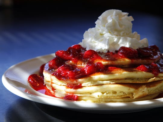 A stack of pancakes with strawberry sauce and whipped cream sits on a table at the Drake Diner. Zach Boyden-Holmes/Juice Photos Zach Boyden-Holmes/Juice A stack of pancakes with strawberry sauce and whipped cream sits on a table at the Drake Diner Feb. 19, 2013.