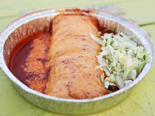 Green chile burrito served enchilada style from Rito's