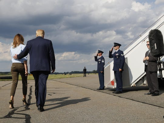 President Donald Trump, with first lady Melania Trump, walks towards Airs Force One after speaking to the media in Morristown, N.J., Sunday, Aug. 4, 2019. (AP Photo/Jacquelyn Martin)