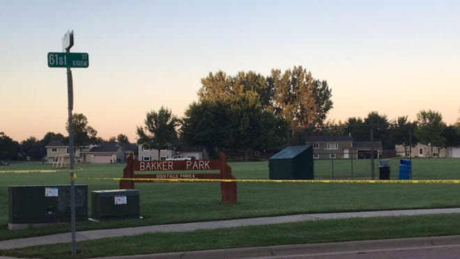 Crime scene tape surrounds a portion of Bakker Park early Tuesday morning.