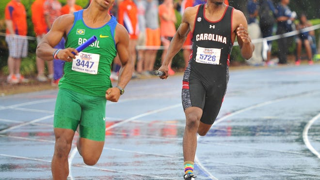 Clayton Gravesande (right, in black) carries the baton for South Carolina.