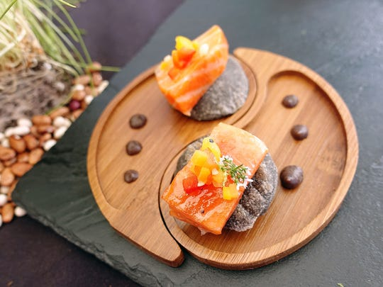 Three sisters: Smoked ocean trout, black tepary bean miso, huitlacoche chumeith and pickled squash from Kai at the 2018 Devour Culinary Classic at Desert Botanical Garden Sunday, March 4, 2018.