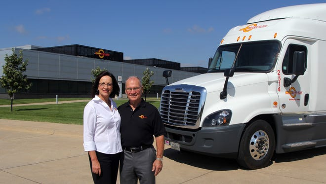Barr-Nunn Transportation CEO Jane Sturgeon and founder Robert Sturgeon stand in front of the company's Granger, Ia. location.