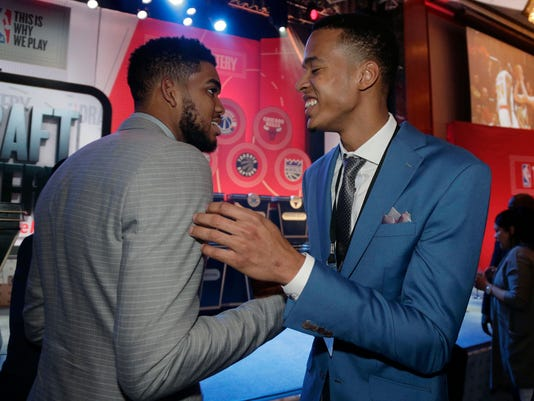 Minnesota Timberwolves center, Karl-Anthony Towns, left, greets draft prospect Skal Labissiere before the start of the NBA basketball draft lottery, Tuesday, May 17, 2016, in New York. (AP Photo/Julie Jacobson)