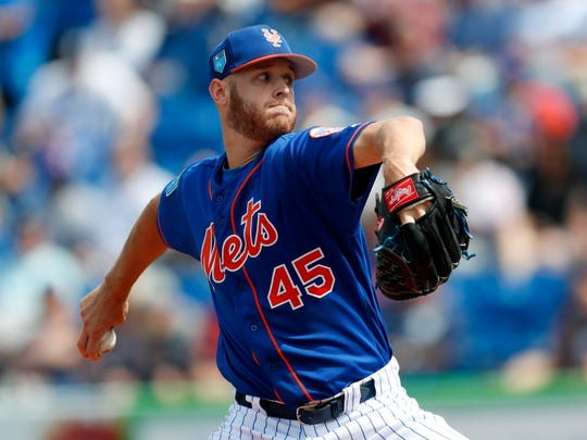 New York Mets starting pitcher Zack Wheeler works against the New York Yankees in the first inning of a spring training baseball game Wednesday, March 7, 2018, in Port St. Lucie, Fla.