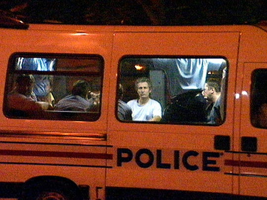 A police van with some of the photographers detained
