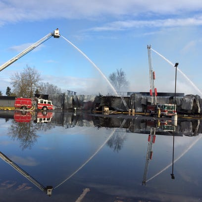Crews continue to extinguish flames at South Albany