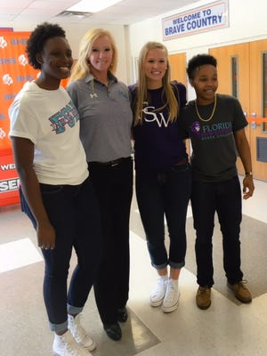 FSW women's basketball coach Kristy Ward poses with new recruits Dajsha Hall, left, and Amanda Oliver and Sadie Desroches.