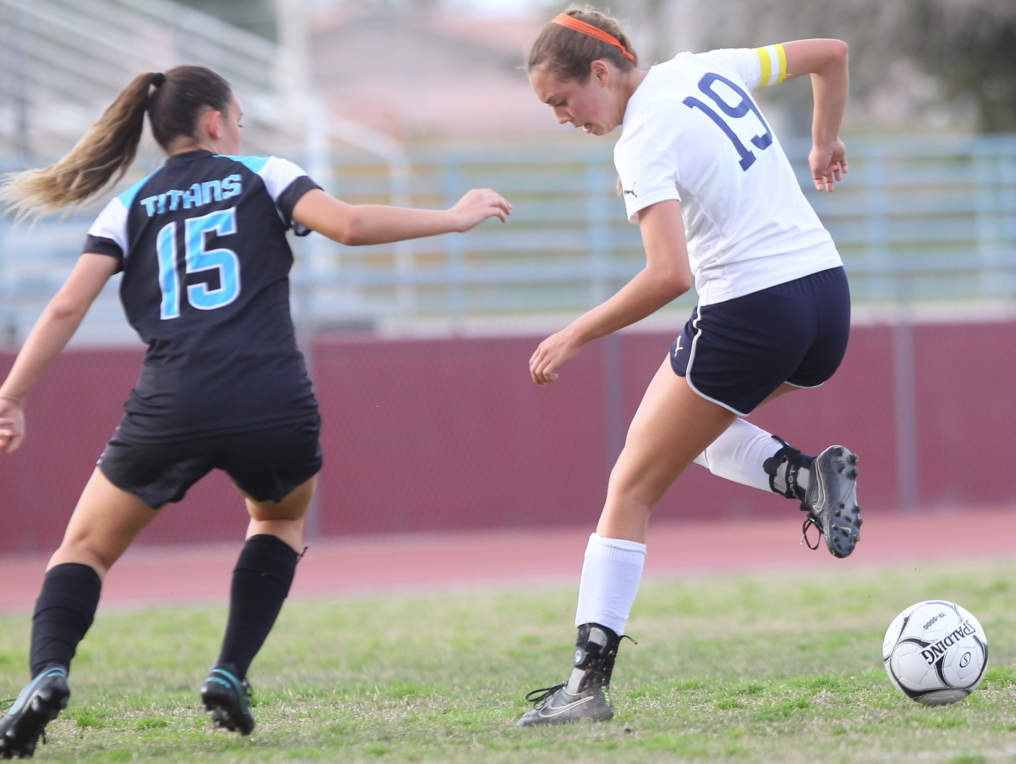 La Quinta High School's Jaylene Manion back heels the ball away from a Grand Terrace High School player at La Quinta on February 16, 2017. La Quinta won 2-1.