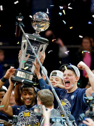 Michigan players celebrate after beating Purdue 75-66 to win the NCAA Big Ten Conference tournament championship college basketball game Sunday in New York.