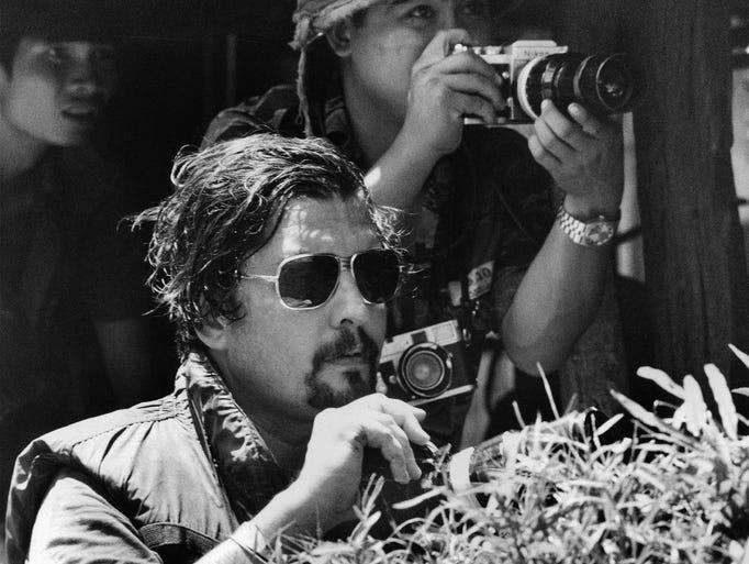Richard Pyle, former Saigon Chief of Bureau, foreground,