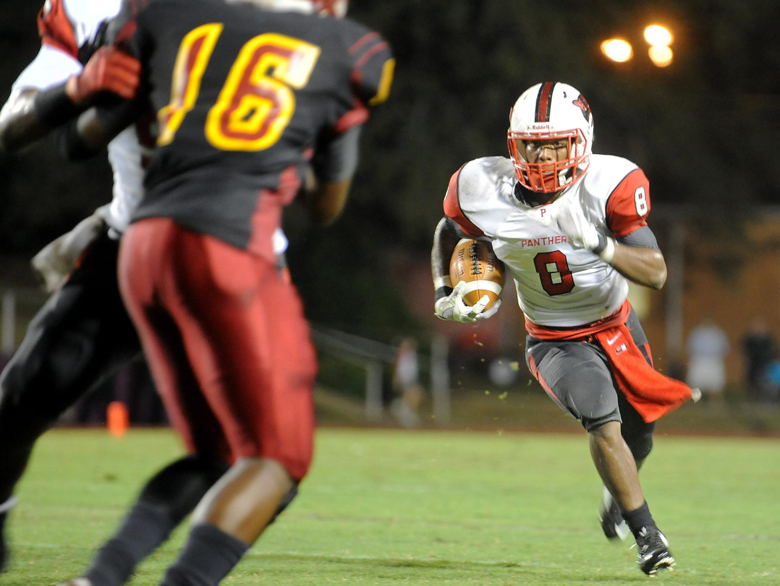 Petal's Stephon Huderson runs the ball Friday night during the Panthers' game at Laurel.