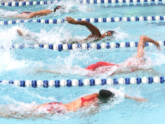Walnut Hills swept the boys and girls titles in Saturday's Greater Mansfield Aquatic Conference swim championships at Clear Fork Swim Club.