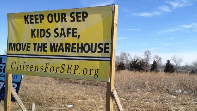 Signs opposing a controversial warehouse development proposal have been placed on properties throughout eastern Polk. County