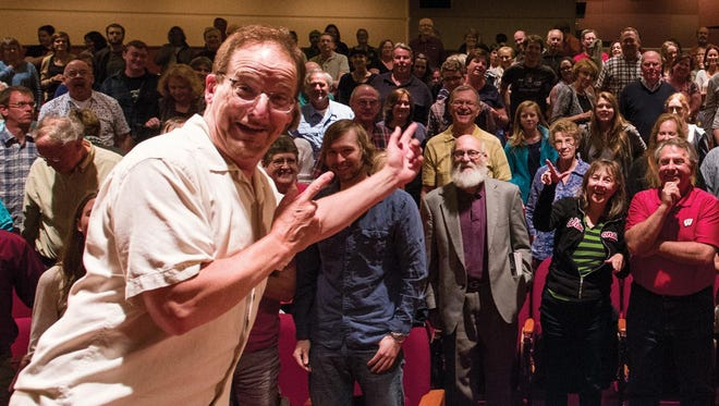 """Whad'Ya Know?"" host Michael Feldman celebrates with the audience of his long-running show in Madison."