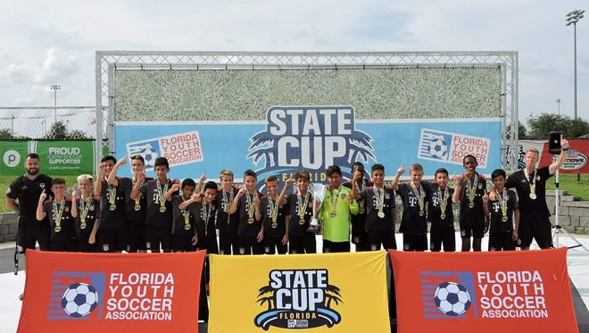 Players and coaches from the GPS Florida West U13 team celebrate after winning the championship at the Florida State Cup over the weekend in Auburndale. Members of the team are Connor Ammons, Cooper Banks, Emanuel Barajas, Thurburn Botterill, Ethan Buesing, Tyler Dwyer, Christyan Fevrier Sildor, Lucas Galvis, Jayson Gordon, Daniel Jaquiss, Ricardo Louis, Adrian Mojica, Marek Novotny, Andrew Pereznegron, Antonio Portes, Kevin Rios, Jack Ross and Jose Vera.
