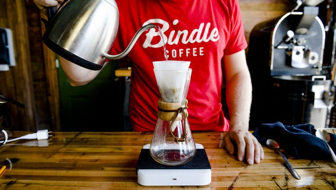 Andrew Webb demonstrates a Chemex pour-over coffee at Bindle Coffee.