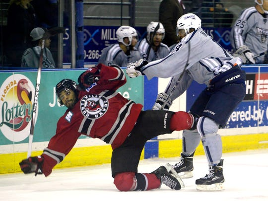 Pensacola Ice Flyers' Junior Harris puts down Huntsville's Cameron Yarwood on during an earlier game this season at the Bay Center. The Ice Flyers play at Huntsville on Friday to begin a busy weekend.