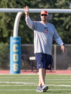COS head football coach Joe D'Agostino leads spring practice on Wednesday, May 2, 2018. This is his first year.