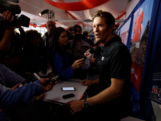 Scott Dixon, of New Zealand, answers a question during