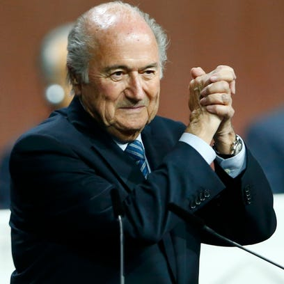 Sepp Blatter gestures after he was re-elected at the
