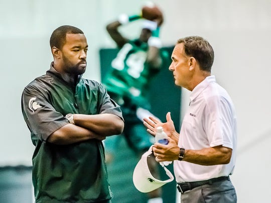 File Coach Mark Dantonio, right, speaks with Curtis Blackwell, the new MSU director of college advancement and performance/camp director, during the first day of preseason camp Aug. 3, 2013, at the Duffy Daugherty Building in East Lansing. MSU Football Head Coach Mark dantonio (right) speaks with Curtis Blackwell, the new MSU director of college advancement and performance/camp director during the first day of preseason camp Saturday August 3, 2013 at the Duffy Daugherty Building in East Lansing. KEVIN W. FOWLER PHOTO