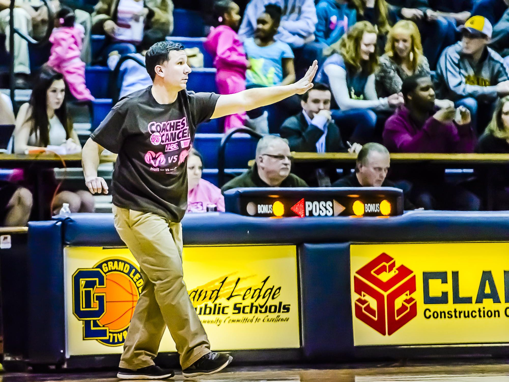 """Coach Matt Essell and Holt combined with rival Grand Ledge for a """"Coaches vs. Cancer"""" basketball game last winter with funds going to the American Cancer Society."""