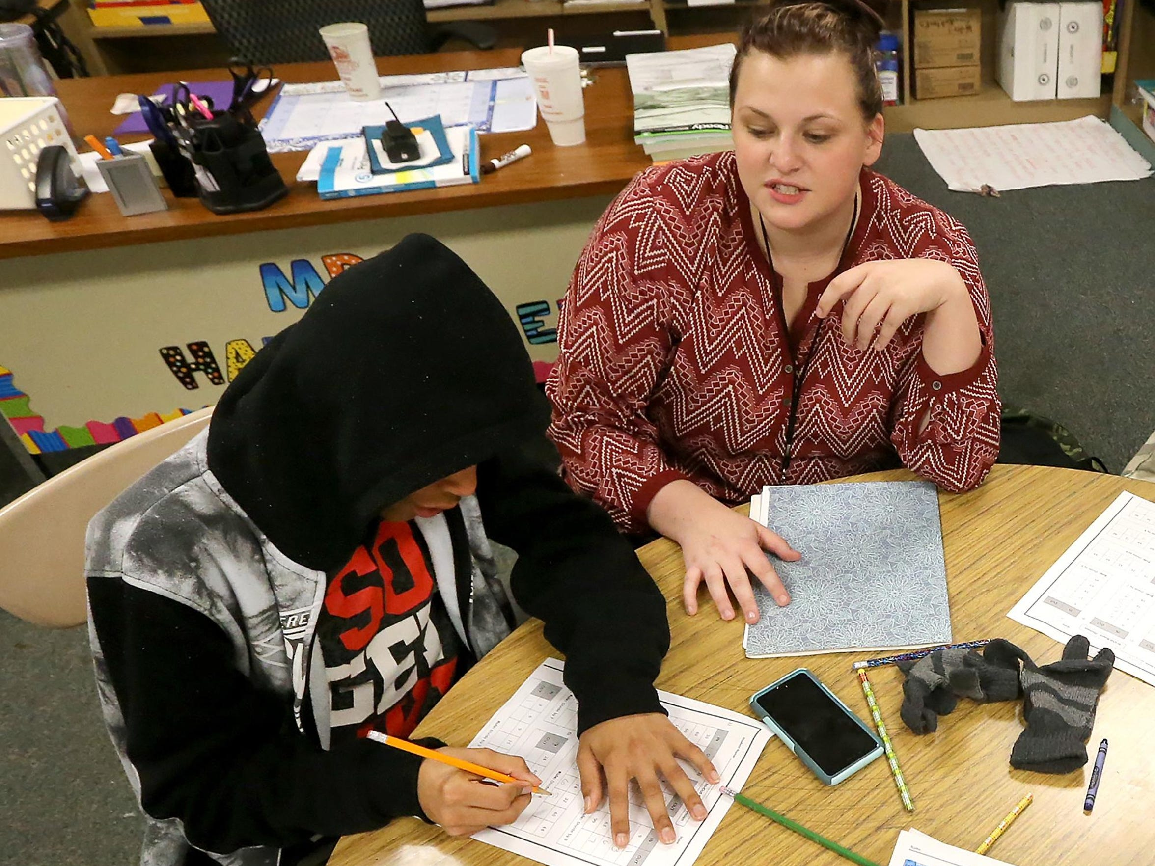 Cortney Cagle, right, a tutoring coordinator at Bradley Academy, helps Damien Malone with a math worksheet during the Bradley Academy After School Tutoring Program on Friday, Jan. 8, 2016.