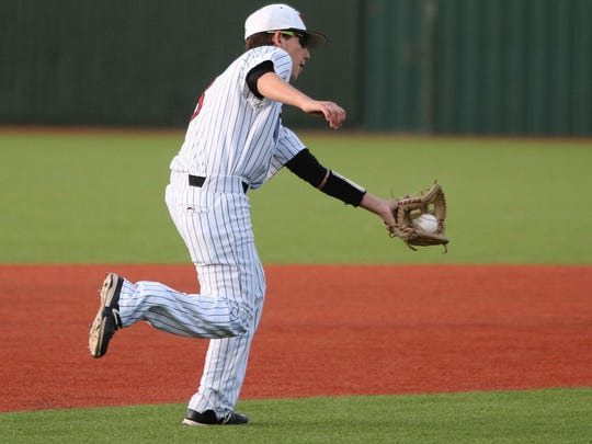 Wichita Falls High's Austin Dyer fields the ground ball in the game against Denison Tuesday, March 14, 2017, in the 5A Region I district opener at Hoskins Field.