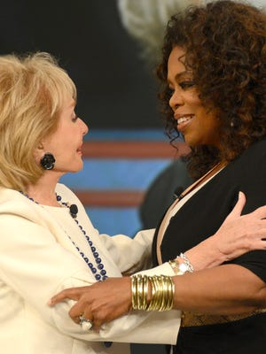 "Barbara Walters embraces Oprah Winfrey during a taping of Walters' final appearance as co-host of ""The View,"" May 15 in New York."
