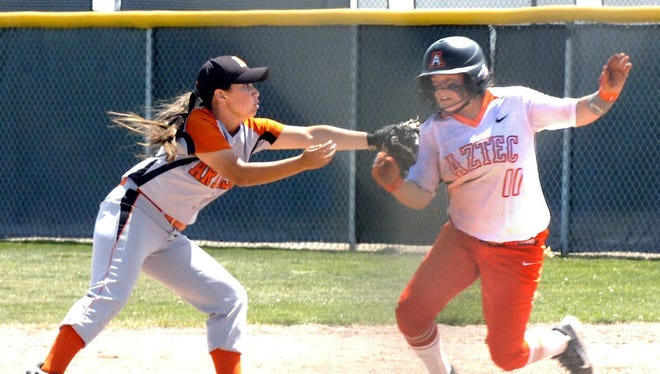 Aztec's CheyAnne Simkins is tagged out by Artesia's Aubree Olguin on Friday in Rio Rancho. Aztec went on to win the game and then faced Piedra Vista later in the day, beating the Lady Panthers to advance to the final. Because of logistical problems, The Daily Times was unable to photograph that game.