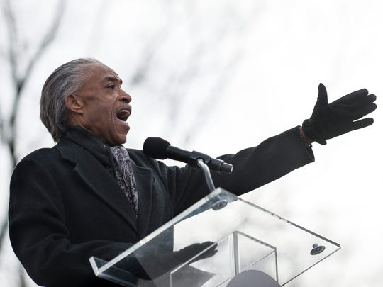 The Rev. Al Sharpton addresses families and supporters