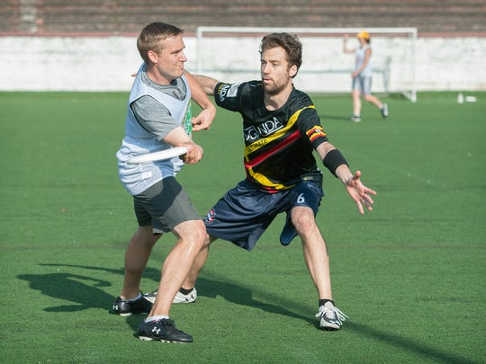 Ultimate frisbee team the Seven Deadly Sins take on Jurassic Mark in an Asheville Ultimate Club game at Memorial Stadium on Wednesday, July 29, 2015.