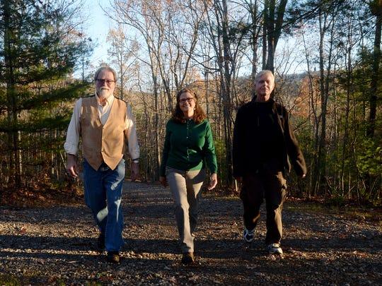 Blue Ridge Naturalist program teachers Scott Dean, left, and Dan Lazar, right, walk down a trail at the North Carolina Arboretum with the program's founder Jeanie Martin. The program is celebrating its 10-year anniversary.