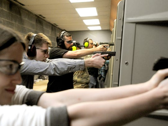 Members of a concealed carry class practice at a private shooting range in 2015.