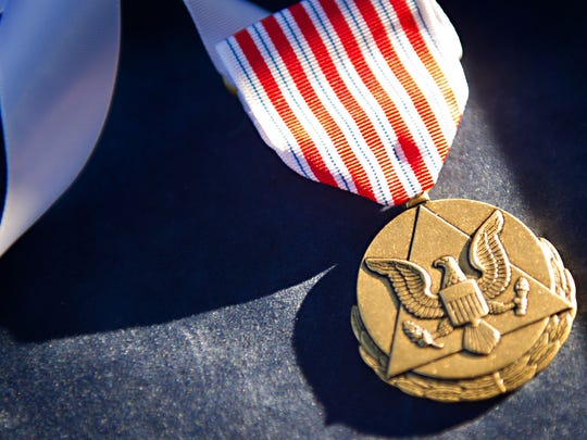 A U.S. Army Outstanding Civilian Service medal sits on a tray prior to an awards ceremony.