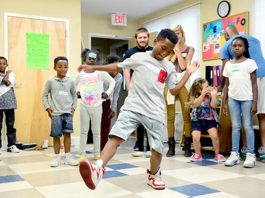 Monte Brooks, 10, shows off his dance moves to other kids in the Children First/Communities in Schools after-school program at Pisgah View Apartments on Tuesday, Sept. 20, 2016. The activity for the day at the program was a LEAF Schools and Streets hip hop dance class.