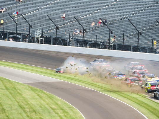 Cars tangle in turn one following a restart of the